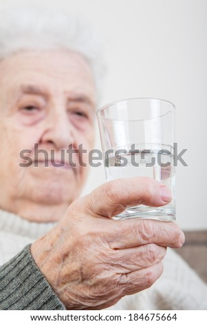 holding a glass of water - stock photo