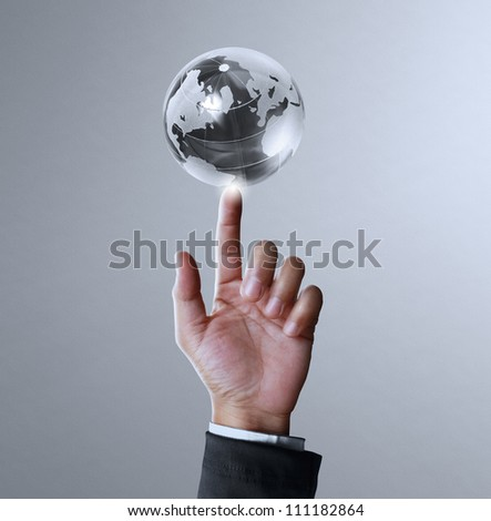 holding a glowing earth globe and hand - stock photo