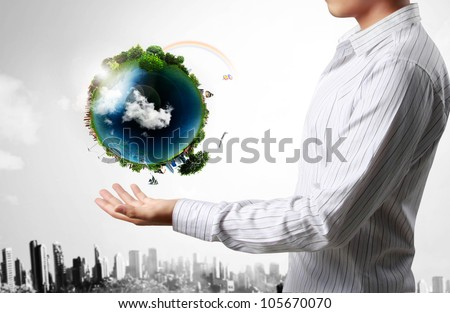 holding a glowing earth globe in his hands - stock photo