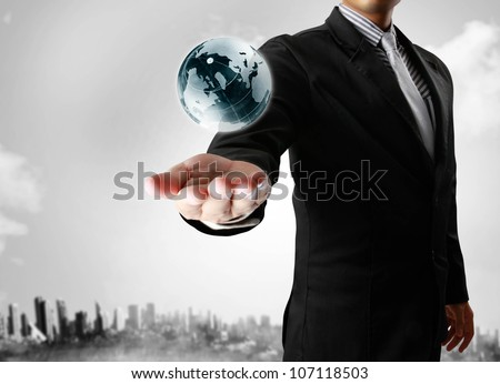holding a glowing earth globe in his hands ,Earth image provided by Nasa.