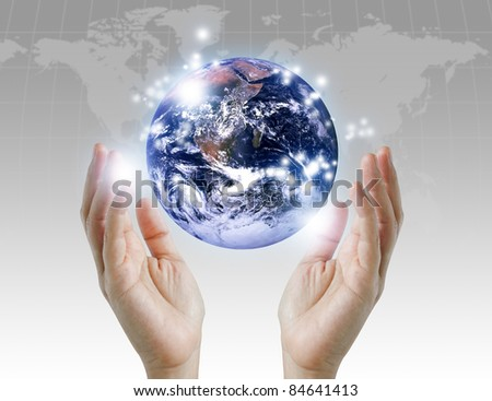 holding a glowing earth globe in his hands. Earth image provided by Nasa. - stock photo