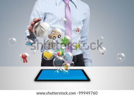 Holding a home in the ball in his hands. - stock photo