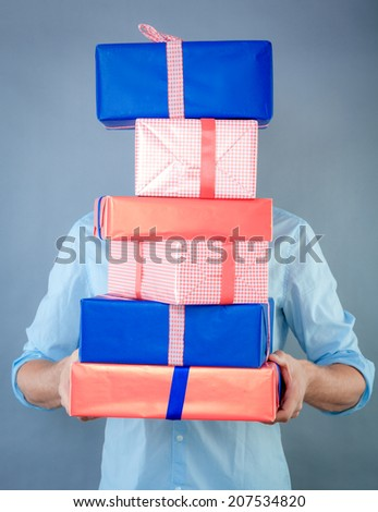holding a lot of gifts for the family - stock photo