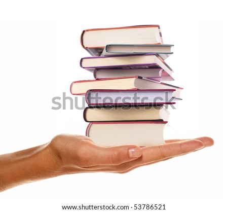 holding a pile of books in the hand - stock photo