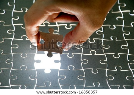 holding a puzzle piece, please check my portfolio for more! - stock photo