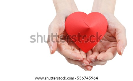 Holding a red heart in hand isolated