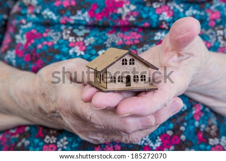 holding a small house - stock photo