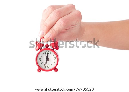 holding a small red clock