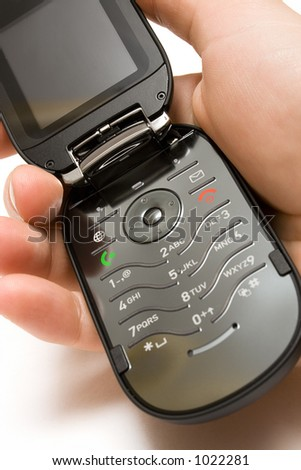 Holding an Open Cell Phone - stock photo