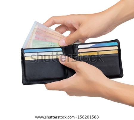 Holding and took the money out of pocket isolated over white background. - stock photo