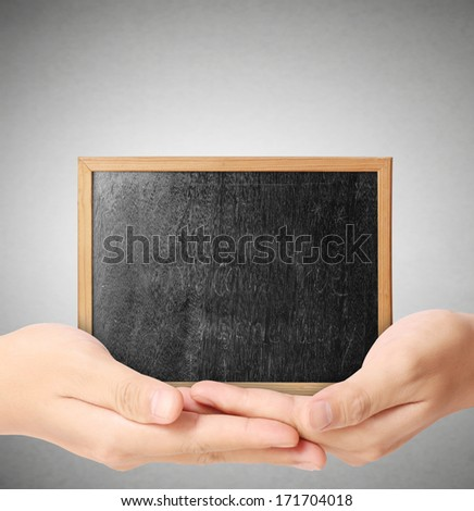 holding blank chalkboard in the hand  - stock photo