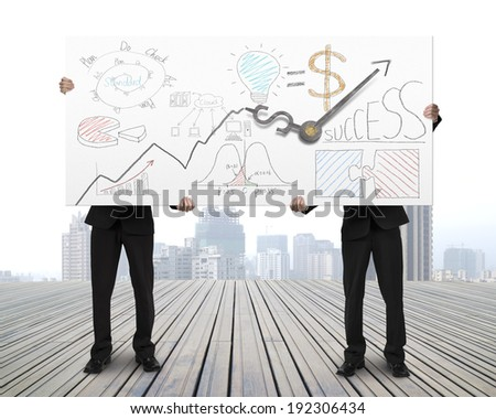 Holding board with business doodles and clock hands on wooden floor - stock photo
