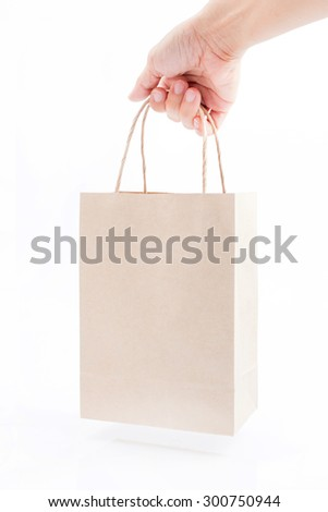 holding brown paper bag isolated on white background - stock photo