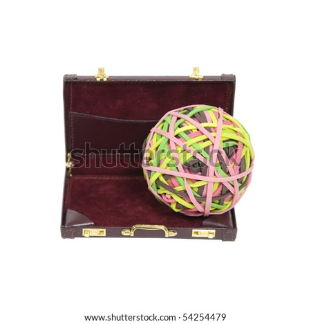 Holding business together shown by a rubber band ball in a leather briefcase - path included