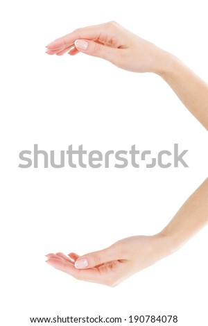 Holding copy space. Close-up of beautiful female hands holding copy space while isolated on white