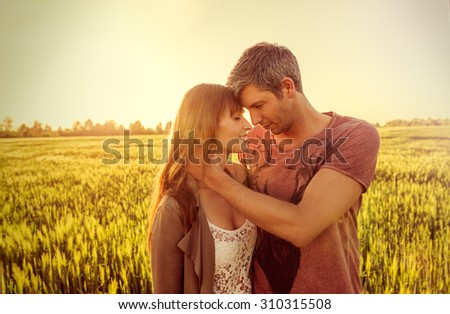 holding eachother while looking the sun - stock photo