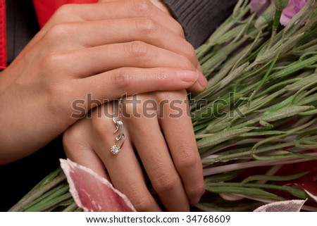 Holding flowers, and diamond necklace