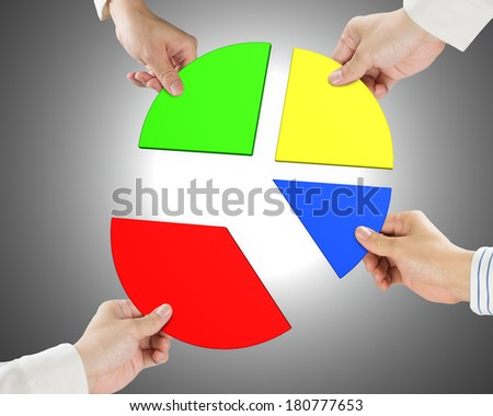 Holding four pie chart pieces gray background