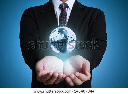 holding glowing earth globe in his hands