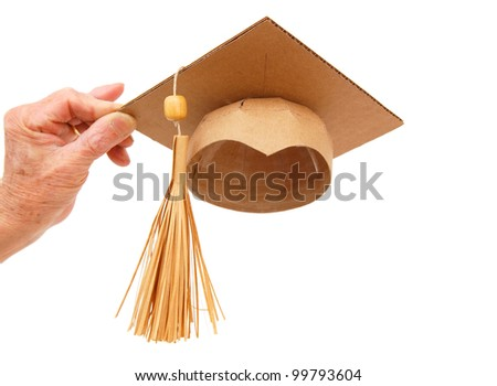 Holding graduating hat concept - stock photo