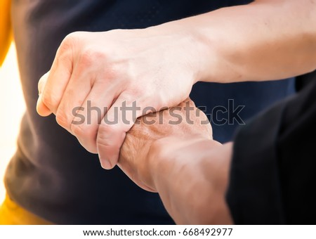 Holding hand to encourage. Close-up