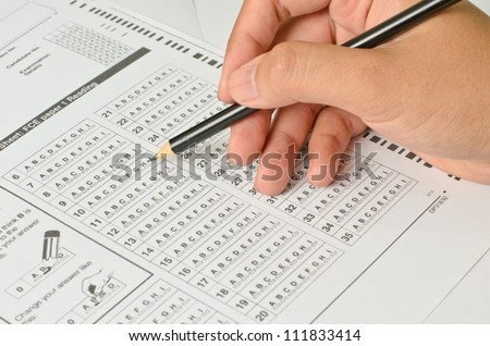 Holding Hand with Answer Sheet - stock photo