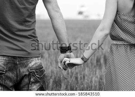 Black And White Photography Of People Holding Hands