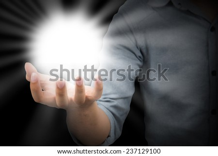 Holding hands open with glowing lights - stock photo