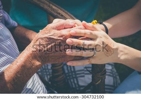 Holding hands. Pray for the elderly. - stock photo