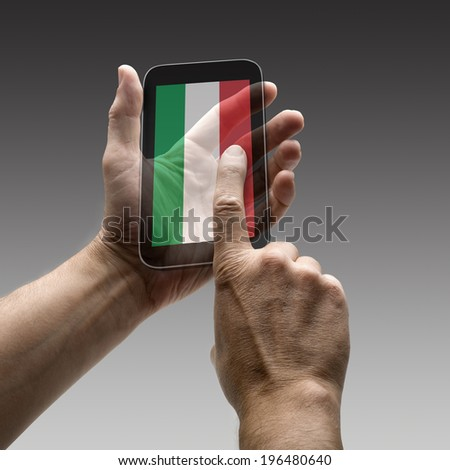 Holding Italy flag screen smart phone. There is a route for hand and finger.  - stock photo