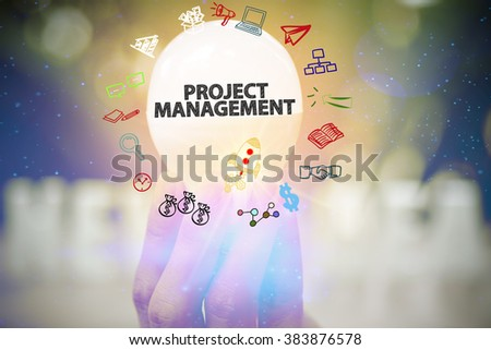 holding light bulb with PROJECT MANAGEMENT text ,business concept ,business idea - stock photo