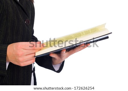 Holding open book or bible and reading carefully every word. - stock photo