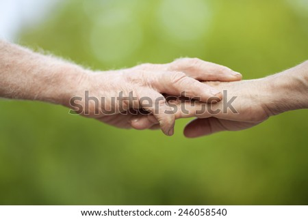 Holding Senior Hands - stock photo