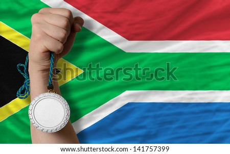 Holding silver medal for sport and national flag of south africa