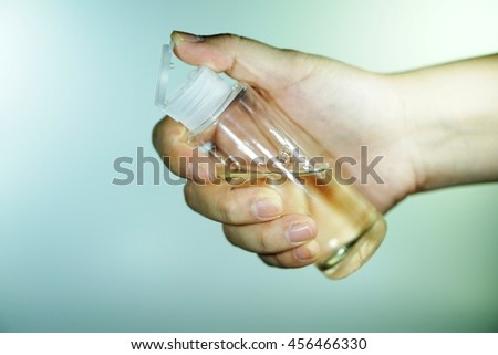 Holding small bottle - close up