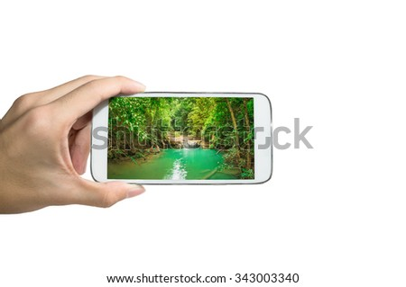 Holding smart phone for capture, Take a photo of Erawan waterfall Kanchanaburi, Thailand.