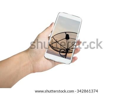 Holding smart phone take a photo of antenna on white background - stock photo