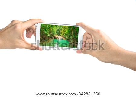 Holding smart phone take a photo of Erawan waterfall on white background