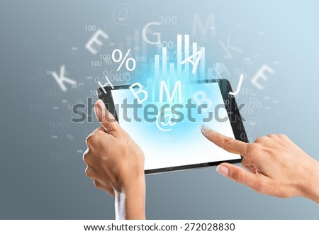 Holding. Tablet computer isolated in a hand on the white backgrounds. - stock photo