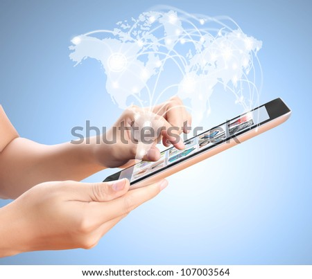 holding touch screen tablet and shows tablet in hand - stock photo