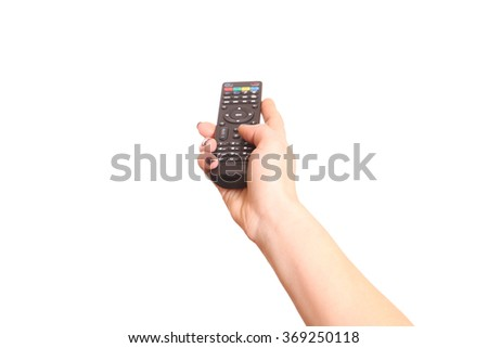 Holding TV remote control. Isolated on white.