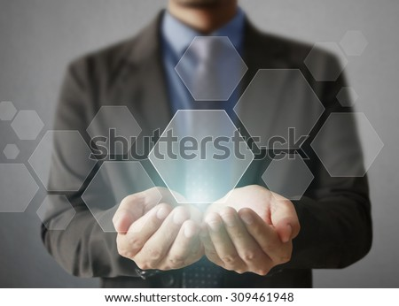 Holding virtual icon of social network in a hand - stock photo