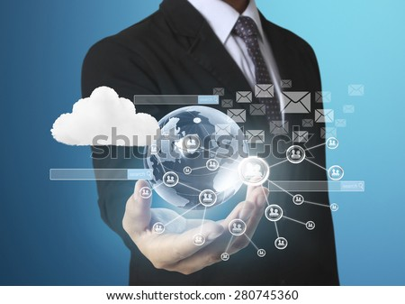 Holding virtual icon of social network in hand - stock photo