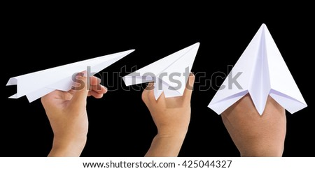 Holding White Paper rocket isolate on black background