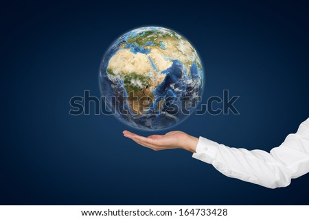 Holding world. Elements of this image furnished by NASA. - stock photo