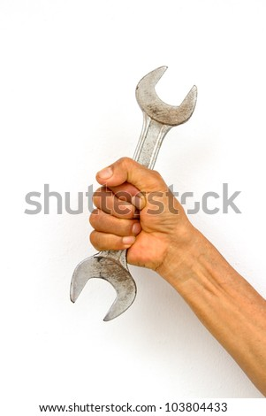 Holding wrench in hand on white background
