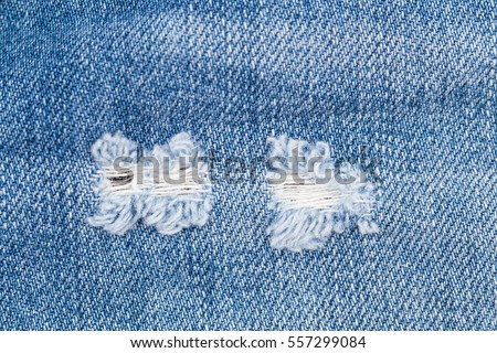 https://thumb1.shutterstock.com/display_pic_with_logo/1769528/557299084/stock-photo-hole-and-threads-on-denim-jeans-ripped-destroyed-torn-blue-jeans-background-close-up-blue-jean-557299084.jpg