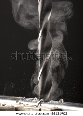 hole being drilled into metal - stock photo
