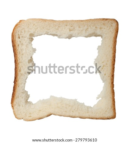 Hole in a slice of bread forming a frame isolated on white background