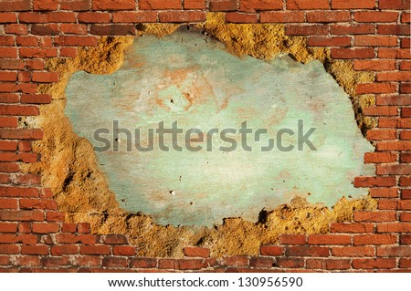 hole in brick wall with plaster